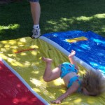 28e8ecf958823aa0b7800796bae7cb27-girl-faceplants-on-slip-n-slide